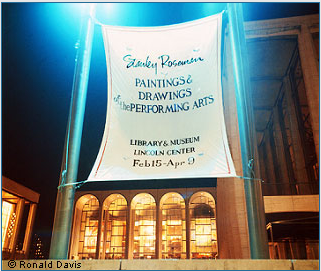 "Lincoln Center Plaza with the banner announcing the exhibition ""Stanley Roseman - The Performing Arts in America"" at the Library and Museum for the Performing Arts, Lincoln Center, New York City, 1977."