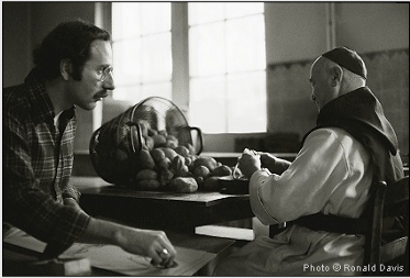 Stanley Roseman drawing a Belgian Trappist monk in the kitchen. Photo by Ronald Davis.