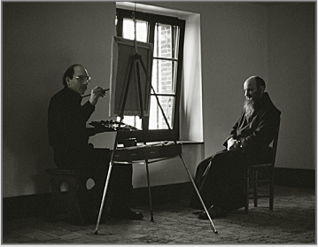 Stanley Roseman painting a portrait of Frère André in a Trappist monastery in France, 2002. Photo by Ronald Davis.